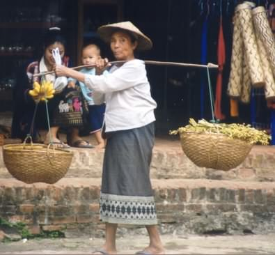 Old woman carrying heavy baskets